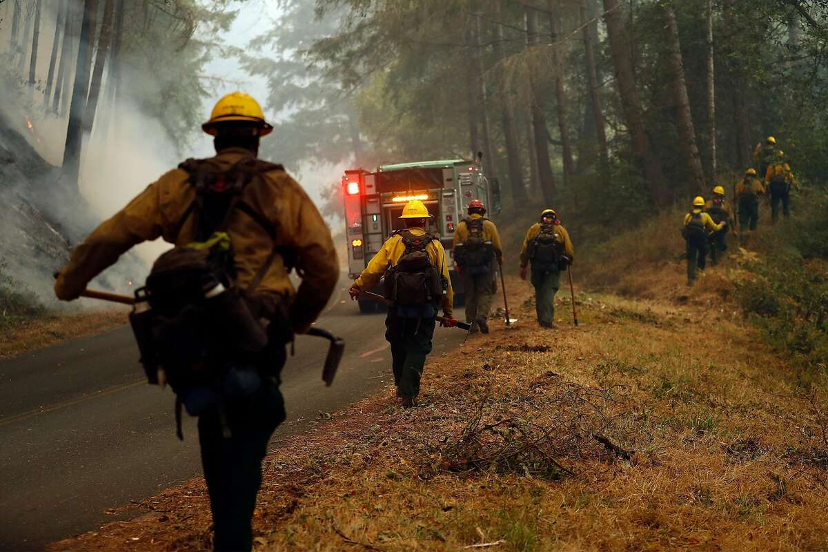 US Forest Service firefighters take part in a firing operation along Limantour Road while Woodward Fire burns in Point Reyes National Seashore in Marin County, California on Sunday, August 30, 2020.