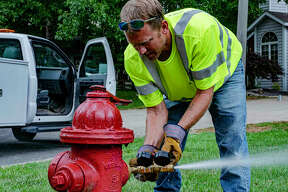Glen Carbon Public Works employee Andy Peck checks the pressure of a fire hydrant near Autumn Glen Drive in Glen Carbon on Friday afternoon. This testing is necessary to assist the Glen Carbon Fire Department to obtain data they need to maintain their ISO rating, or International Organization for Standardization.