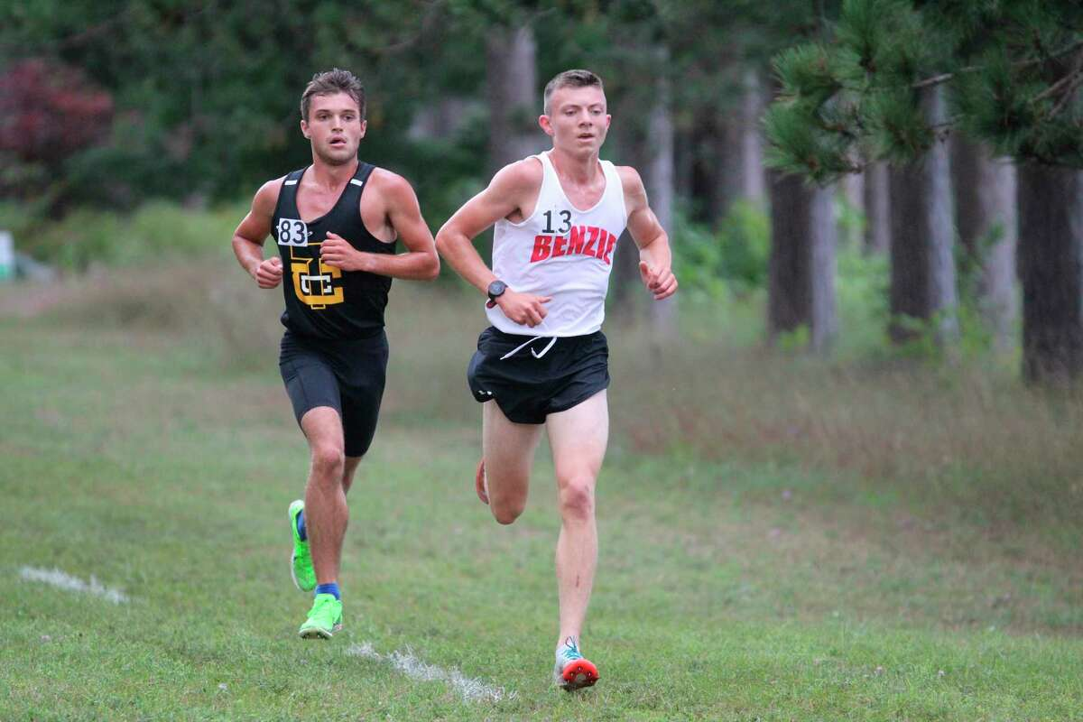 Benzie Central's Hunter Jones runs just ahead of Traverse City Central'sDrew Seabase at the midway point of Saturday's race. (Submitted photo/Gary Pallin)