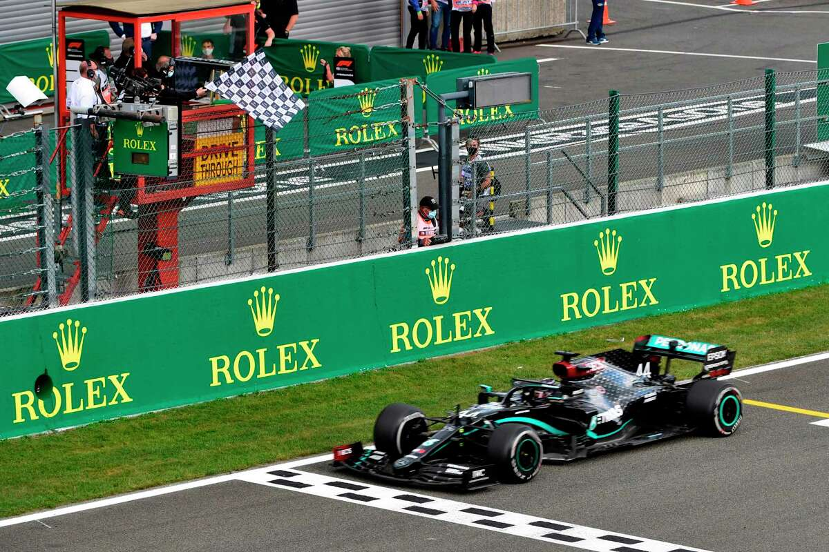 TOPSHOT - Mercedes' British driver Lewis Hamilton crosses the finish line to win the Belgian Formula One Grand Prix at the Spa-Francorchamps circuit in Spa on August 30, 2020. (Photo by JOHN THYS / POOL / AFP) (Photo by JOHN THYS/POOL/AFP via Getty Images)