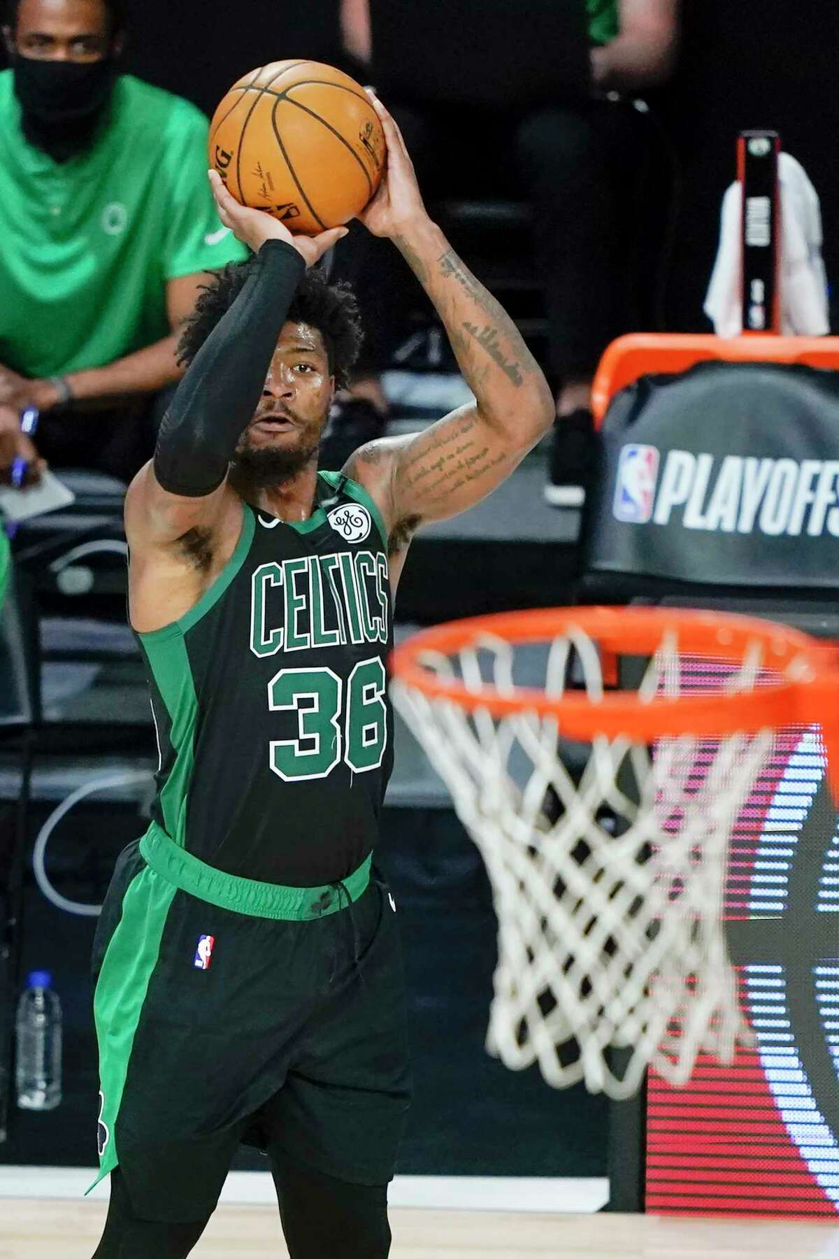 Boston Celtics' Marcus Smart shoots against the Toronto Raptors during the second half of an NBA basketball conference semifinal playoff game Sunday, Aug. 30, 2020, in Lake Buena Vista, Fla. (AP Photo/Ashley Landis)