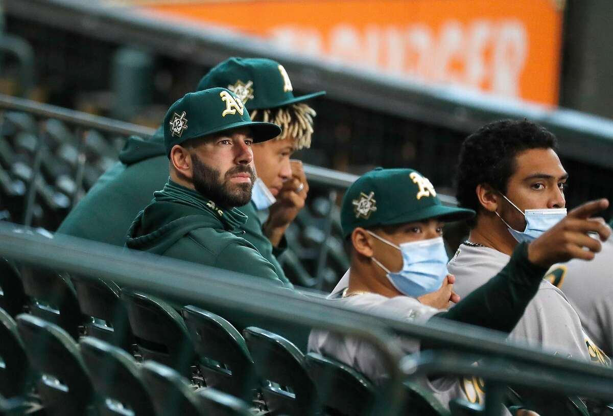 Former Houston Astros pitcher now Oakland Athletics pitcher Mike Fiers sits in the stand during the first inning of game one of a double header during an MLB baseball game at Minute Maid Park, Saturday, August 29, 2020, in Houston.