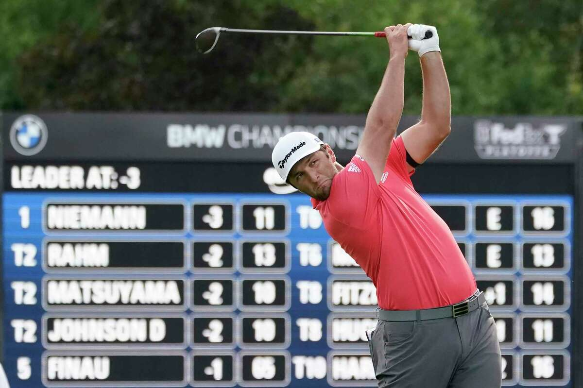 Jon Rahm hits from the 14th tee during the final round of the BMW Championship golf tournament at the Olympia Fields Country Club in Olympia Fields, Ill., Sunday, Aug. 30, 2020. (AP Photo/Charles Rex Arbogast)