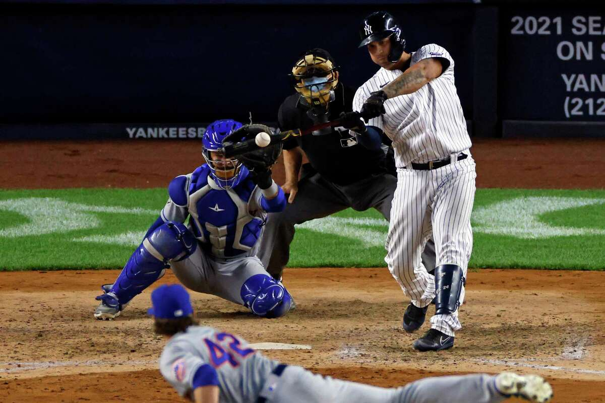 New York Yankees' Gary Sanchez hits a grand slam off of New York Mets pitcher Drew Smith during the eighth inning of the second baseball game of a doubleheader, Sunday, Aug. 30, 2020, in New York. (AP Photo/Adam Hunger)