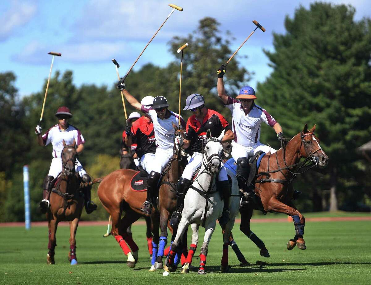 Polo teams Altares and Gardenvale compete in the opening round of the East Coast Open Championship at the Greenwich Polo Club in Greenwich on Sunday. The match was open to spectators with mask wearing and social distancing rules in place.