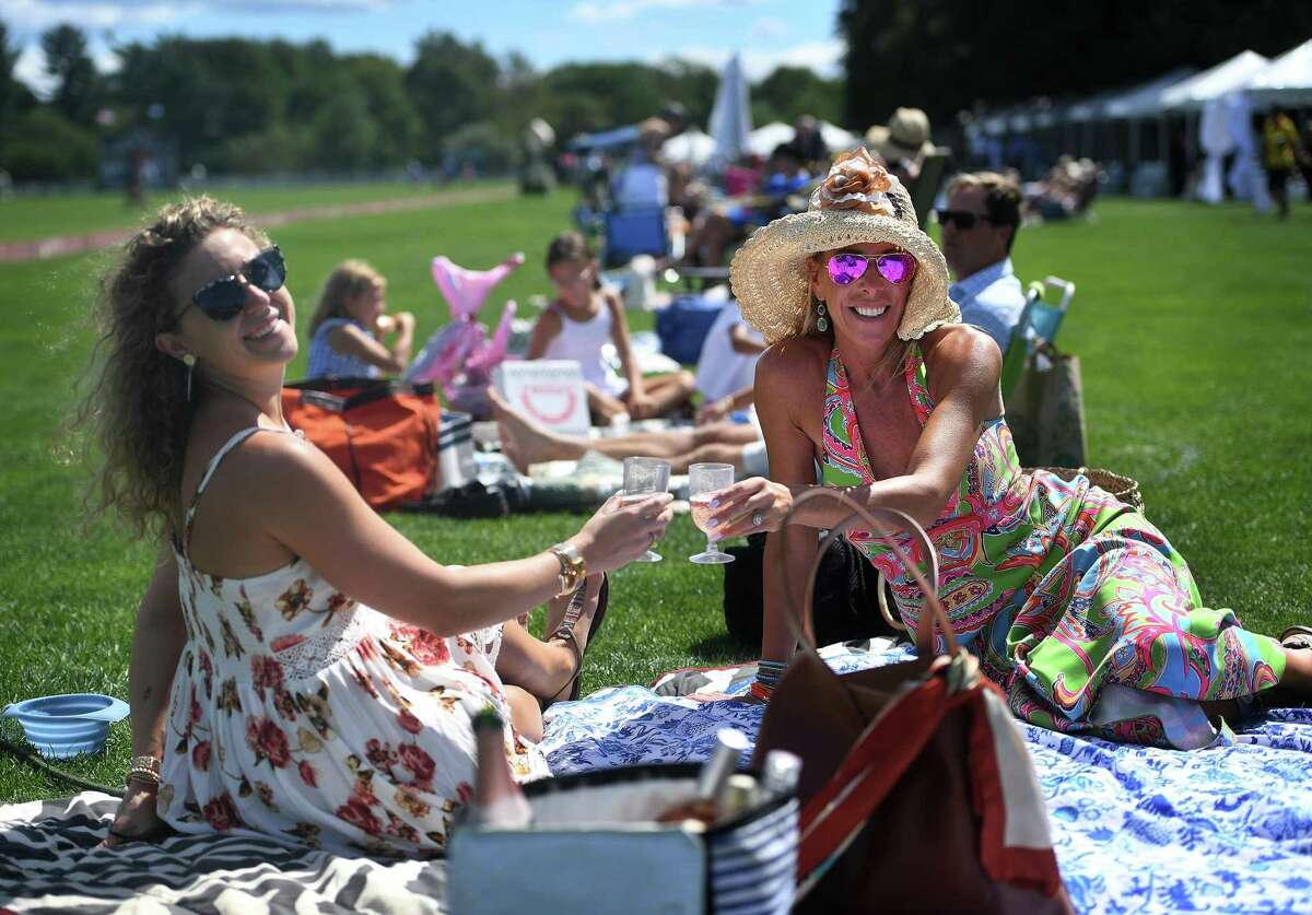 Friends Sara Bakrow, left, of Greenwich, and Jackie McCaffery, of Westport, attend the East Coast Open Championship. The match was open to spectators with mask wearing and social distancing rules in place.