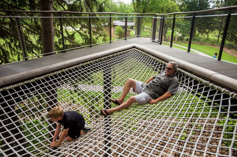 Just hanging out Rick Gerard of Bay City, right, explores the Whiting Forest Canopy Walk with his grandson, Wyatt Wackerle, 7, Thursday afternoon in Midland. For more photos, visit www.ourmidland.com. (Katy Kildee/kkildee@mdn.net)
