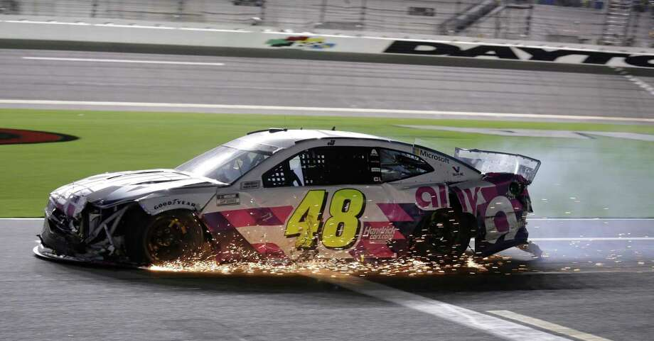 Jimmie Johnson drives his damaged car on pit road during the NASCAR Cup Series auto race at Daytona International Speedway, Saturday, Aug. 29, 2020, in Daytona Beach, Fla. (AP Photo/Terry Renna) / Copyright 2020 The Associated Press. All rights reserved