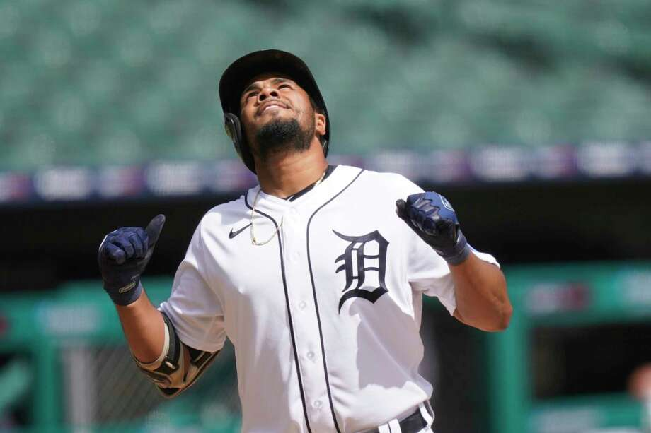 Detroit Tigers' Jeimer Candelario approaches home plate after a solo home run off Minnesota Twins starting pitcher Kenta Maeda during the fourth inning of a baseball game, Sunday, Aug. 30, 2020, in Detroit. (AP Photo/Carlos Osorio) / Copyright 2020 The Associated Press. All rights reserved.