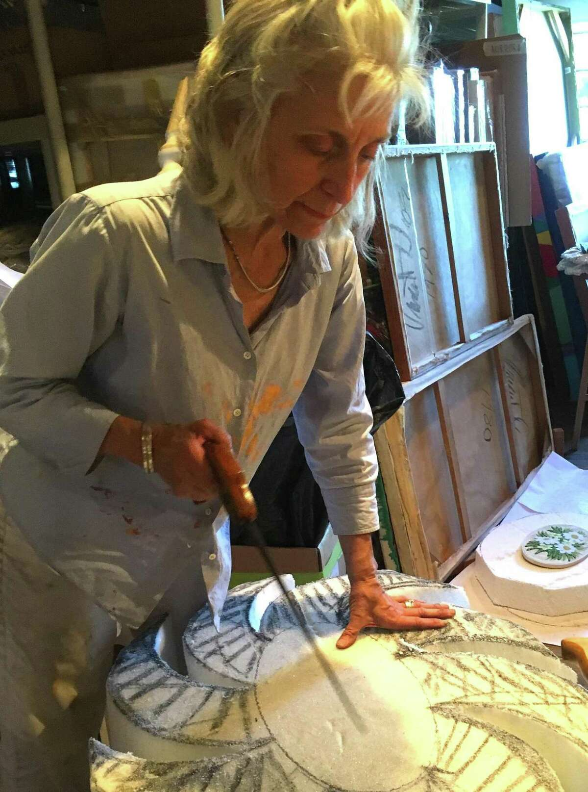 Artist Lydia Viscardi at work in her studio in Newtown.