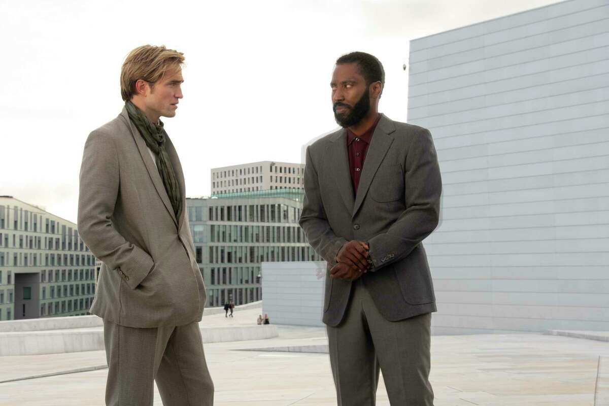 """Robert Pattinson (left) and John David Washington star in """"Tenet,"""" which opens this week in U.S. theaters."""