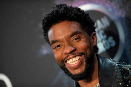 this November 24, 2019, file photo actor Chadwick Boseman poses in the press room during the 2019 American Music Awards at the Microsoft theatre in Los Angeles.