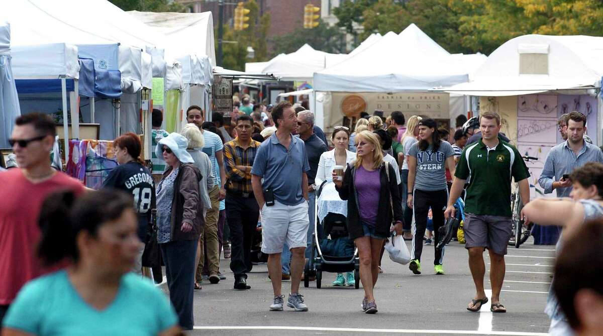 The Arts & Crafts on Bedford Street event in Stamford takes place Sept. 12. The above photo was taken in 2017. This year's event will feature ferwer exhibitors to ensure plenty of space to spread out the booths and allow for social distancing, organizes said.