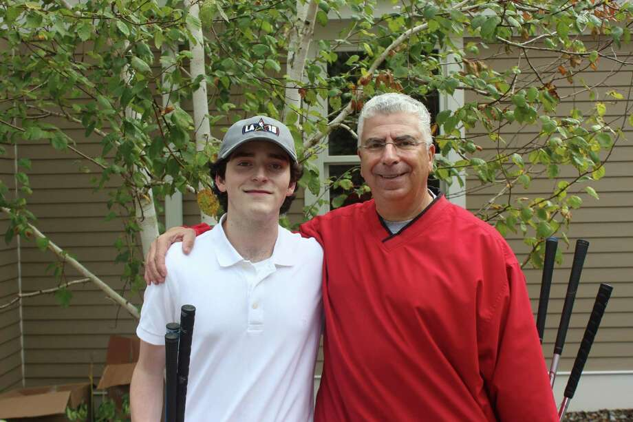 John Capilli with his son, John Capilli Jr. Photo: Regional Hospice, Danbury / Contributed Photo