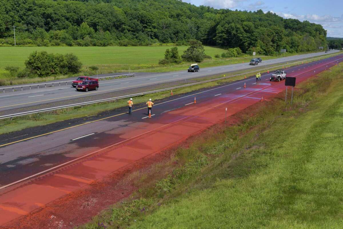 Crews work washing off a powdered chemical that spilled on the westbound lane of Interstate 90 near exit 26 on Monday, August 31, 2020, in Rotterdam, N.Y. State Police said that a tractor trailer hauling a load of the dry chemical, possibly iron oxide, spilled the substance on the thruway. (Paul Buckowski/Times Union)