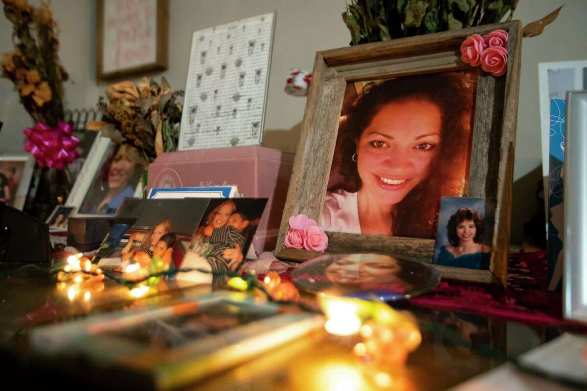 Rosie Peña maintains a tribute to her daughter, Linda Pena Cordona, who was murdered in 2017, Sunday, Aug. 2, 2020, inside her Houston home. The family has now been waiting years for the accused killer to go to trial. Court documents show that Ricardo Olivarez pleaded guilty in early October and was taken back into custody, but the judge has reinstated his bond, and Olivarez is still out of custody waiting for trial. Harris County currently has a backlog of more than 1300 people awaiting trial on murder or capital murder charges.