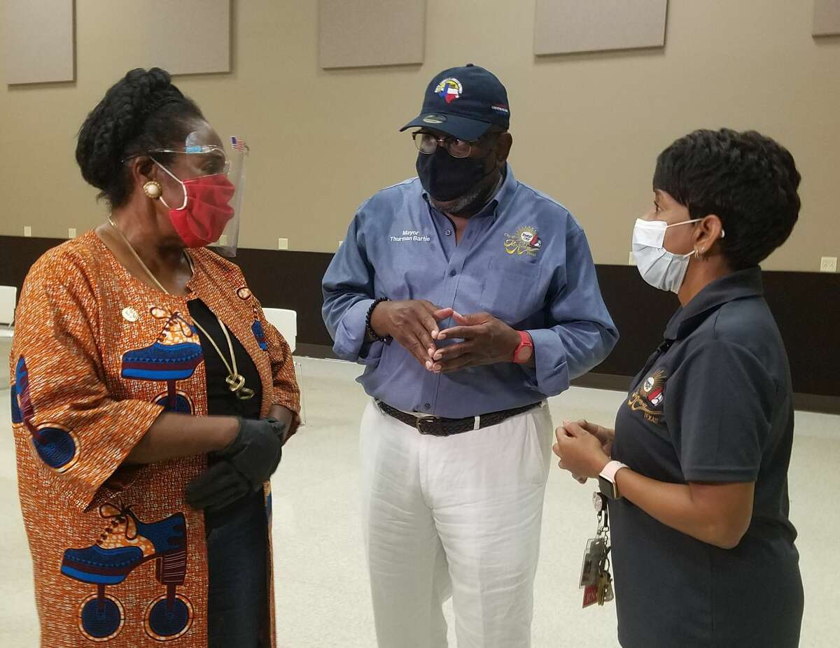 U.S. Rep. Sheila Jackson Lee, D-Houston, left, chats with Pott Arthur Mayor Thurman Bill Bartie and Health Director Judith Smith at the Port Arthur Civic Center on Monday as the city prepares for the return of evacuees.