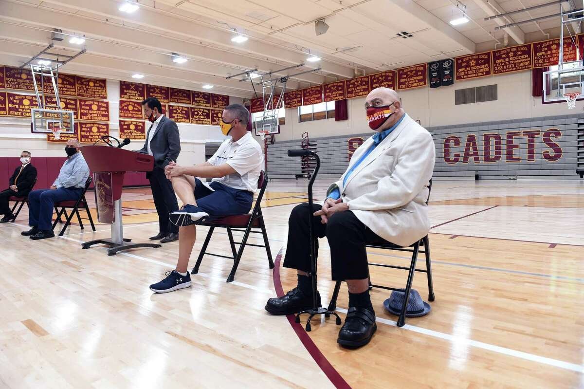 Former St. Joseph High School basketball coach Vito Montelli (right) attends a ribbon cutting ceremony at the school's renovated gym rededicated in his honor in Trumbull on August 28, 2020.