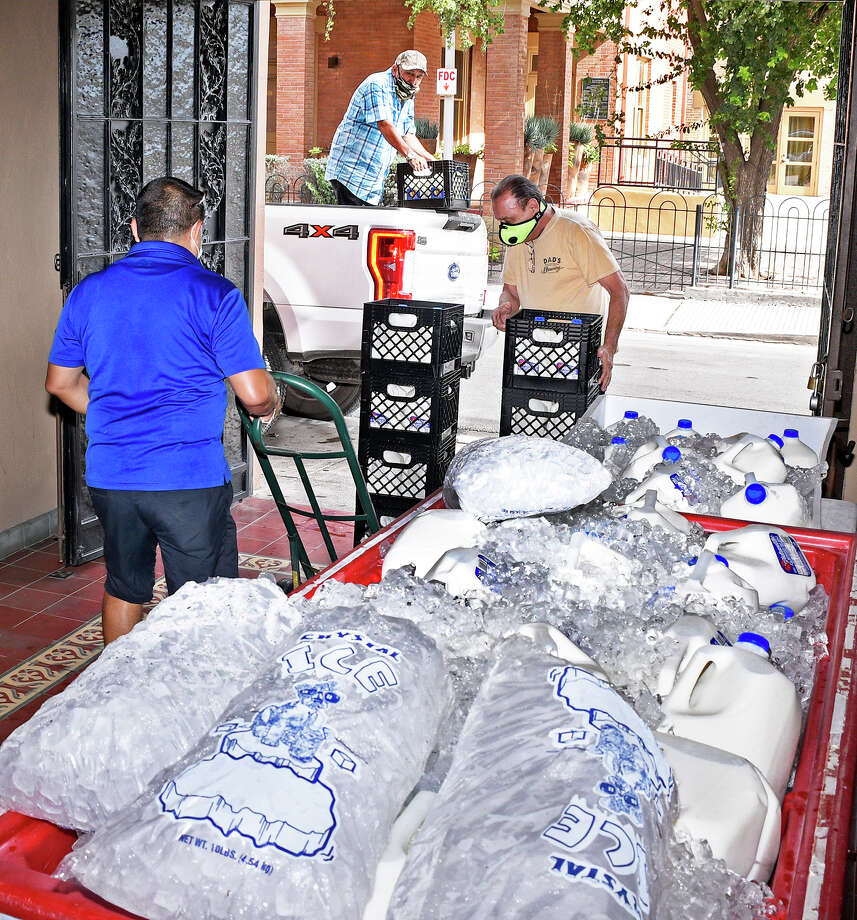 Volunteers from the Universal Life Church, the South Texas Afghanistan nd Iraq  Veterans Association, and from American Legion Post 59 distributed 1,700 gallons of milk to Laredoans in south Laredo, Wednesday, August 26, 2020. Photo: Cuate Santos/Laredo Morning Times