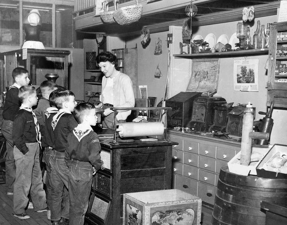 Mrs. Virginia Stroemel, former director of the Manistee County Historical Museum, talks history to a group of Boy Scouts circa 1960s. (Manistee County Historical Museum photo)