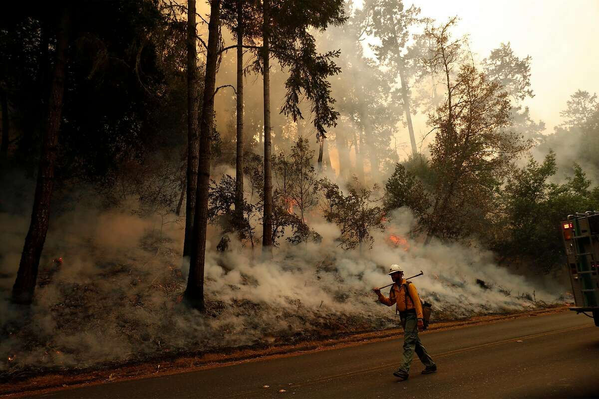 A U.S. Forest Service firefighter works during the Woodward Fire at in Point Reyes National Seashore in Marin County.