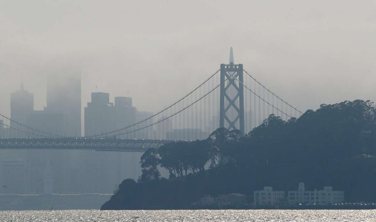 San Francisco's skyline is obscured by a mixture of smoke and fog as seen from Oakland, Calif., on Sunday, August 30, 2020.