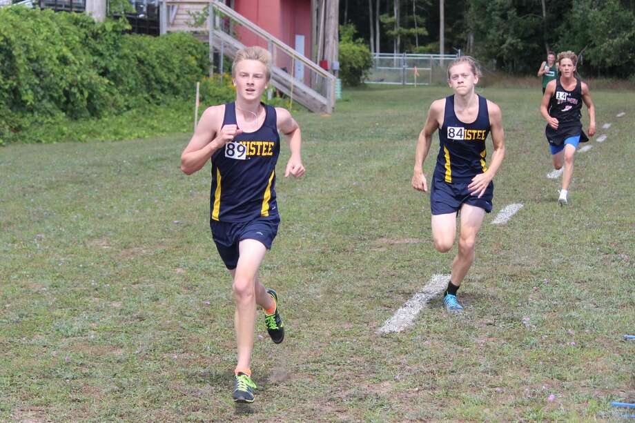 The Manistee Chippewas race at the Moss Invitational on Saturday at Benzie Central. Photo: Robert Myers