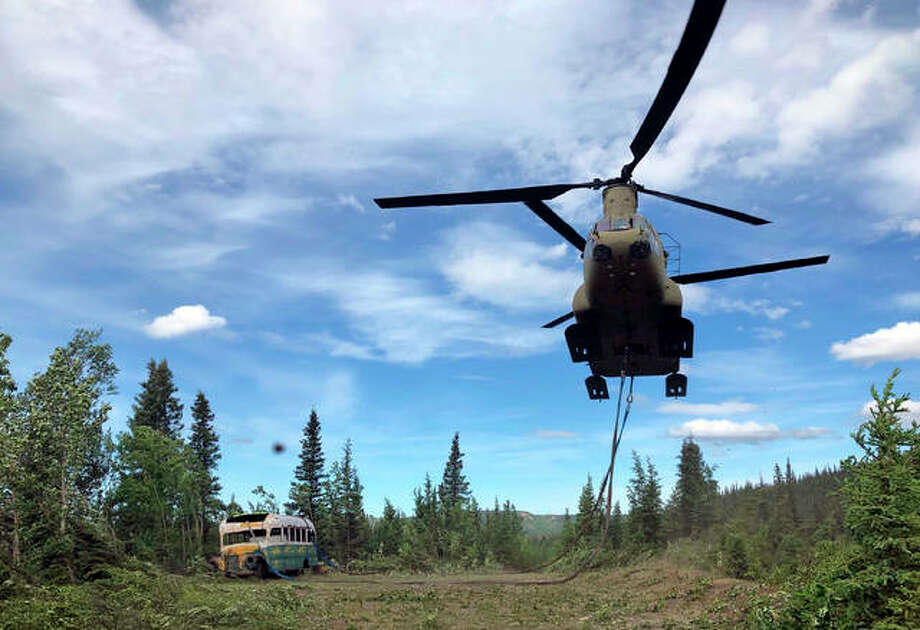 While they probably will not have to remove a famous bus in California, Illinois Army National Guard troops will use a helicoper much like the one shown here in Alaska. Photo: Hearst File Photo