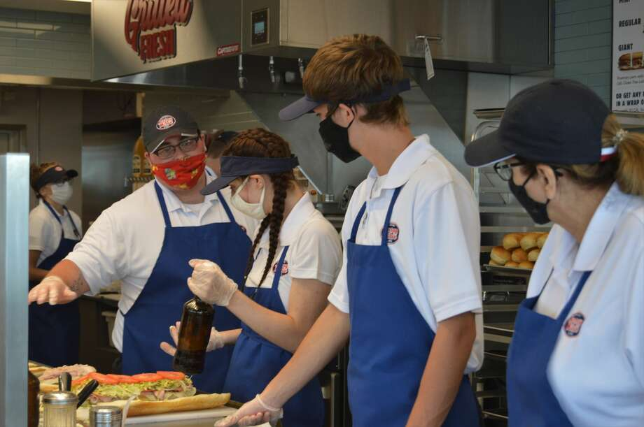 Employees train at the new Jersey Mike's Subs location on Monday, Aug. 31 at 1917 S. Saginaw Road in Midland, preparing for the grand opening on Wednesday. (Ashley Schafer/Ashley.Schafer@hearstnp.com) Photo: Ashley Schafer