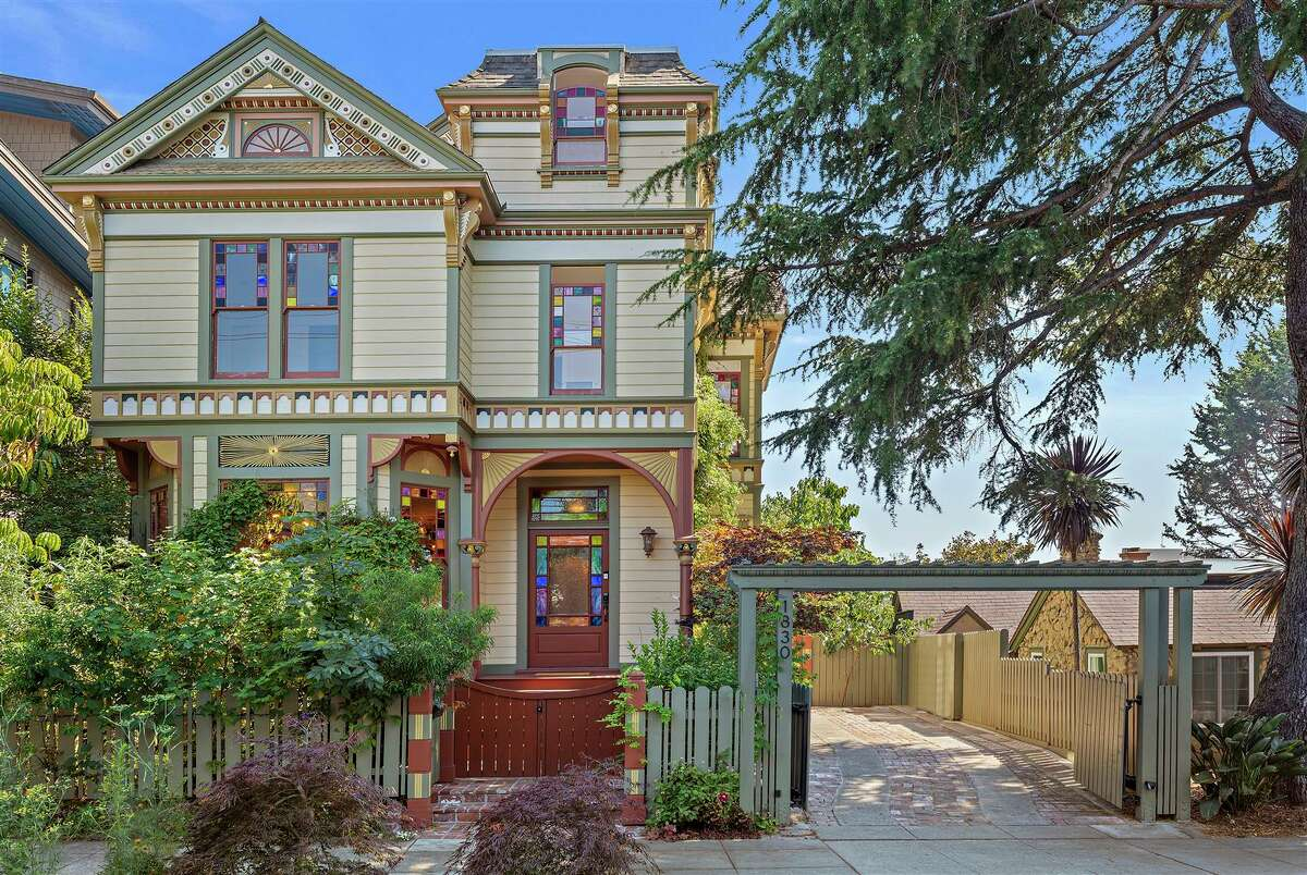 The home spans 3,460 square feet behind a storybook facade, under a gabled roof.