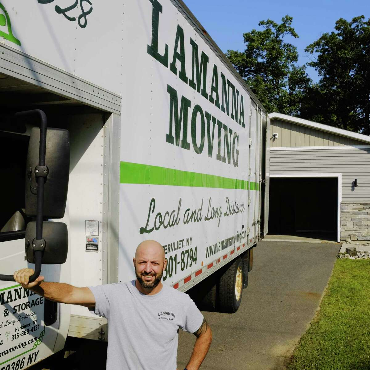 Steve Lamanna, owner of Lamanna Moving, poses outside a client's home on Monday, Aug. 24, 2020, in Halfmoon, N.Y. (Paul Buckowski/Times Union)