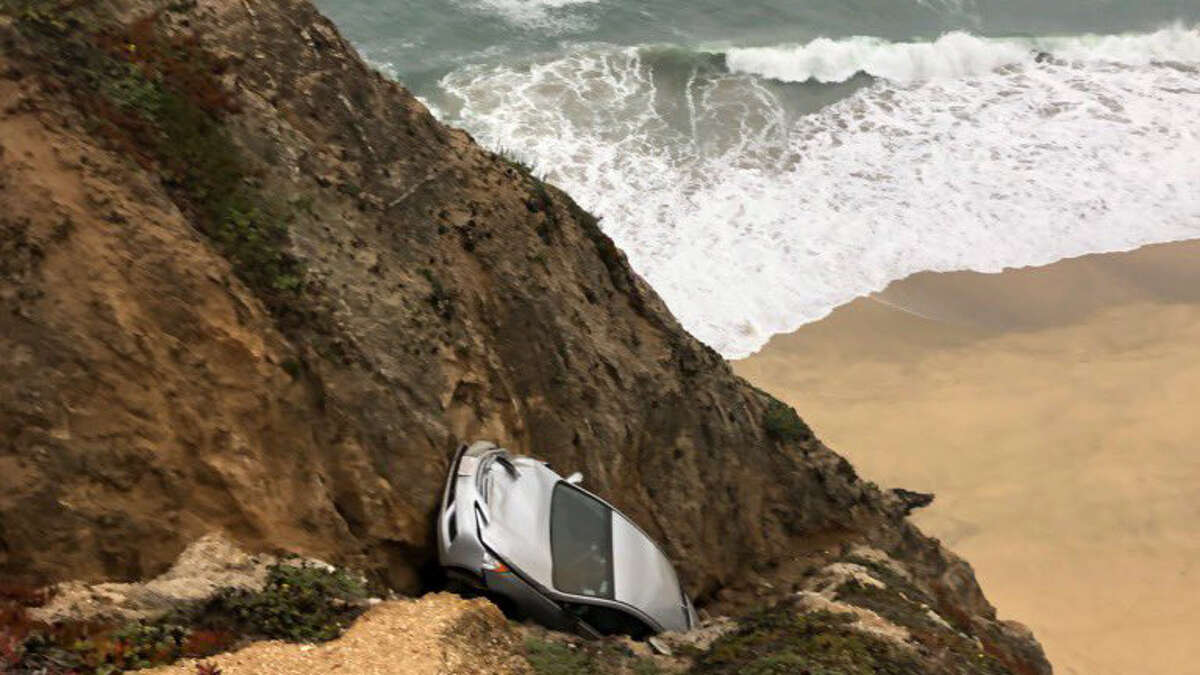 Firefighters are at scene of a vehicle that tumbled over a cliff off Highway 1 near Gray Whale Cove south of Devils Slide in San Mateo County.