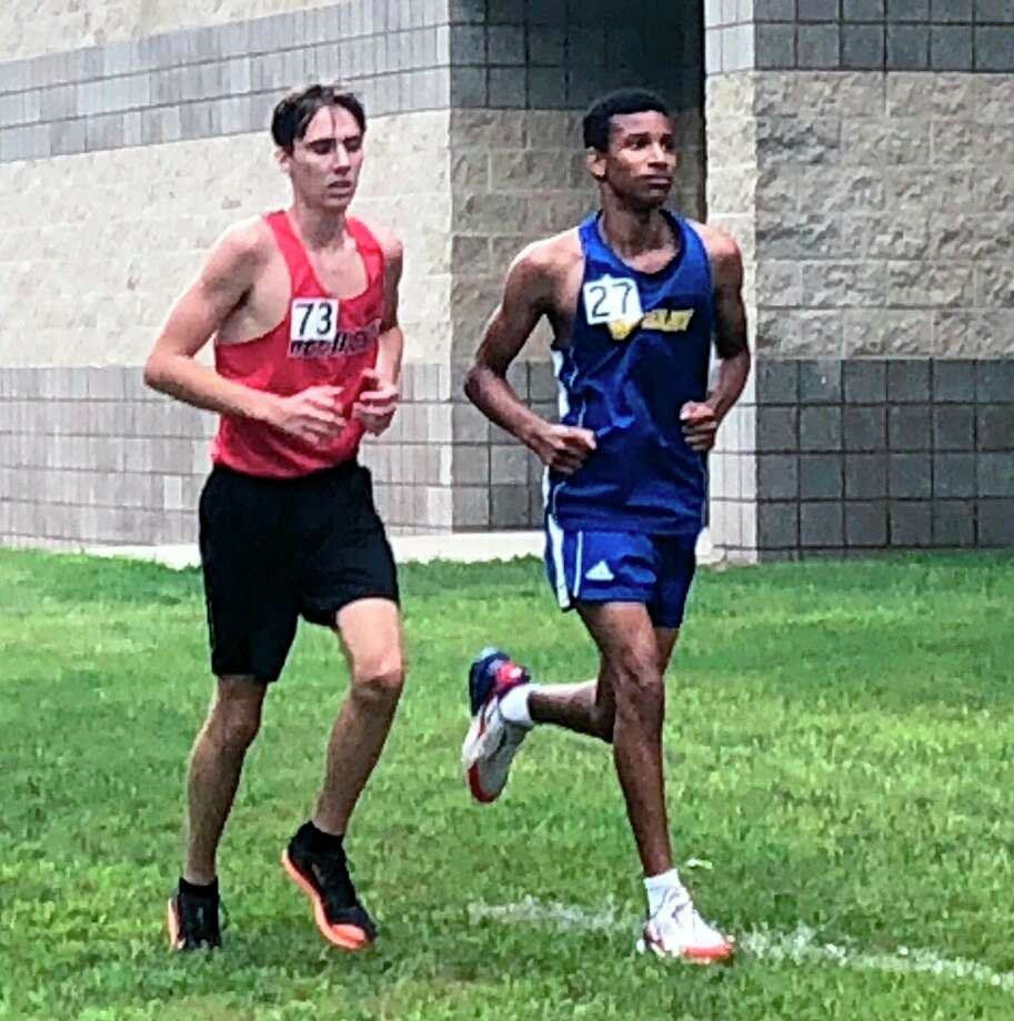Reed City's Gavin Throop (left) runs in a race during the 2019 season. (Courtesy photo)