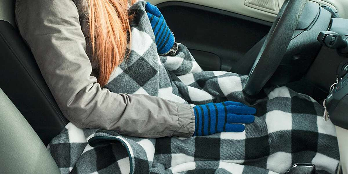 This Heated Blanket Plugs Into Your Car: The 12-volt fleece blanket from Stalwart on Amazon plugs into the cigarette lighter and it warms up for the coziest car ride ever. You can order one for under $30.