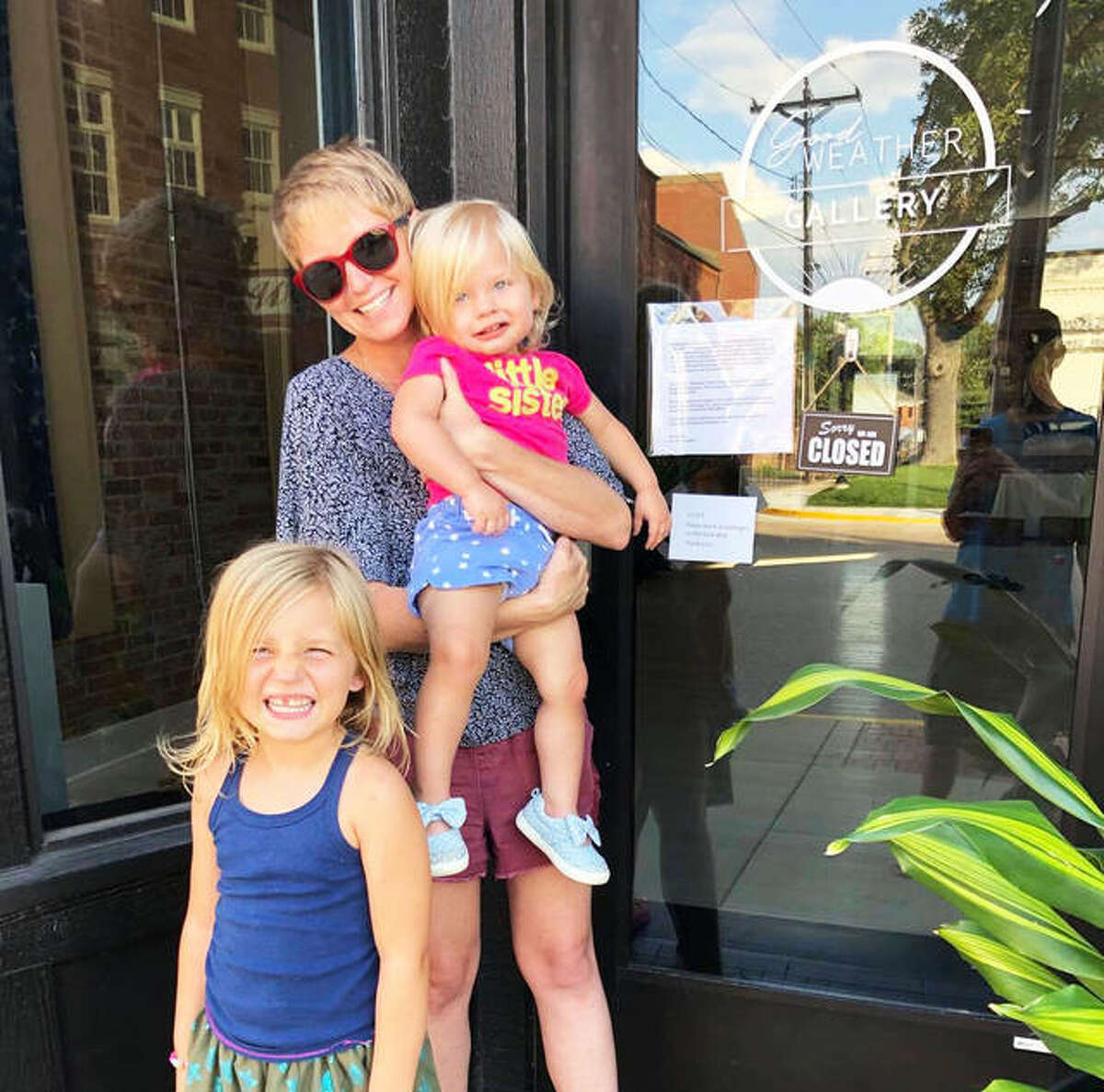 Good Weather Gallery owner and curator Brooke Peipert, of Alton, opened the independent gallery in Edwardsville one year ago. She stands with her daughters Juniper, 1, right, who was only a few months old when the gallery opened, and Hazel, 5, both of whom are always at the gallery and inspiration for Peipert.