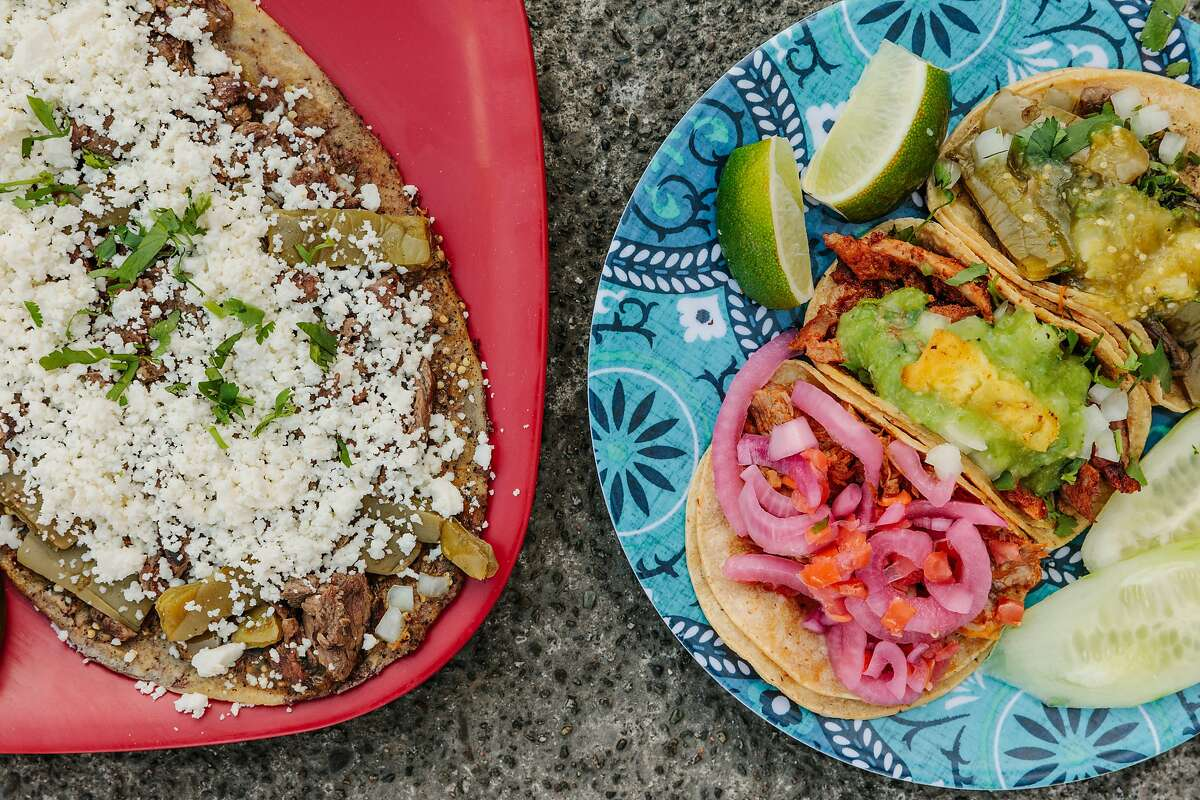 Asada and nopales huarache (left), and cochinita, al pastor, and veggie tacos at Los Carnalitos in Redwood City.