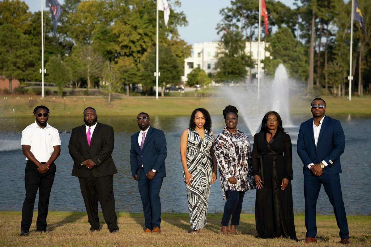 From left to right, Von Gardner, Reginald Easley, Marcus Humphrey, Lisa Johnson, TJ Dock, Andrea McWashington and LaDon Johnson pose for a portrait at Veteran's Memorial Park, Monday, Aug. 17, 2020, in Conroe.