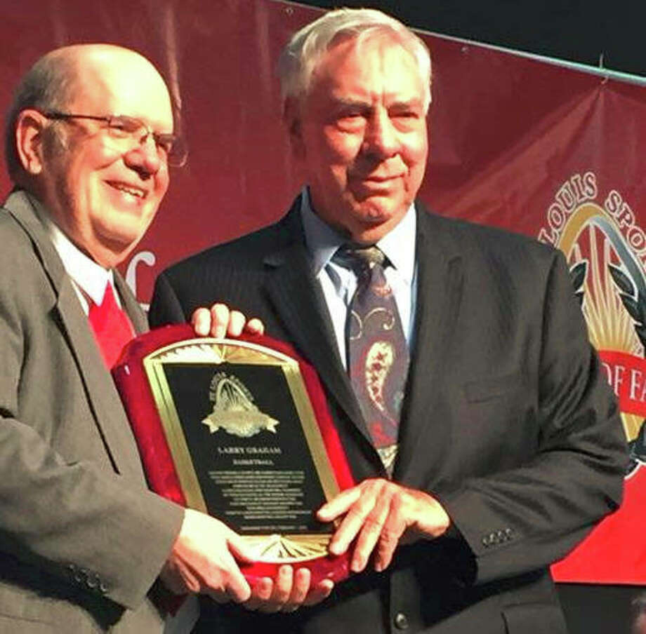 Former SIUE men's basketball coach Larry Graham, right, is pictured with former Alton Telegraph sports reporter Steve Porter at the St. Louis Sports Hall of Fame enshrinement banquet in 2018.