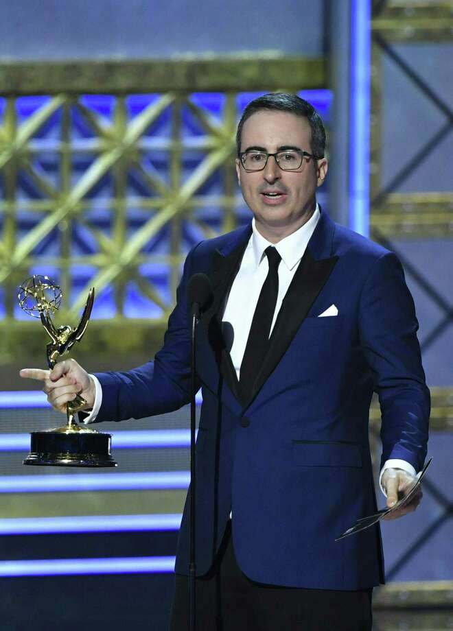 """John Oliver accepts the award for Outstanding Writing for a Variety Series for """"Last Week Tonight With John Oliver"""" inn 2017 in Los Angeles, California. Photo: FREDERIC J. BROWN / AFP /Getty Images / Internal"""