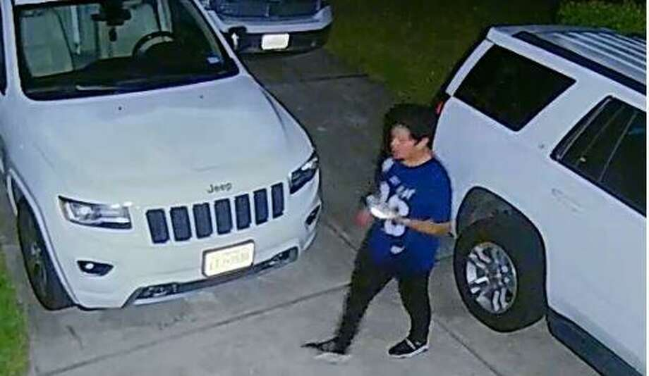 Authorities are looking for a man caught on camera allegedly breaking into vehicles in a Conroe subdivision. Photo: Courtesy Of Conroe Police Department