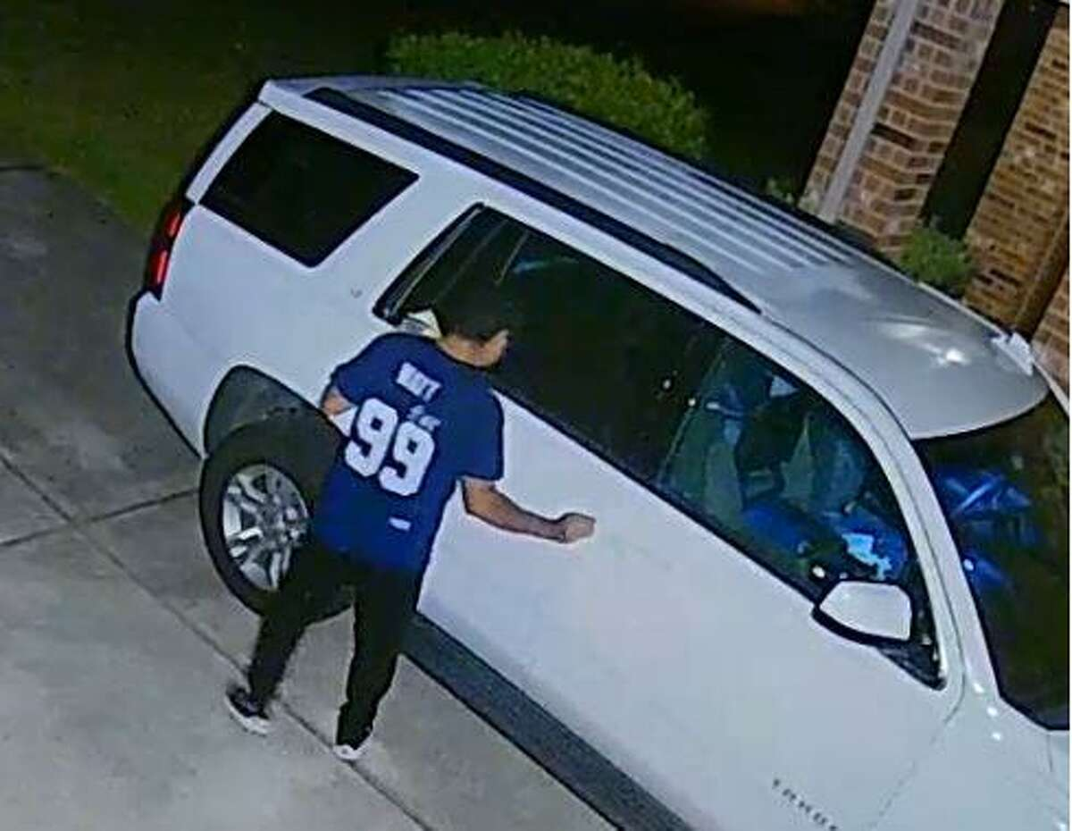 Authorities are looking for a man caught on camera allegedly breaking into vehicles in a Conroe subdivision.