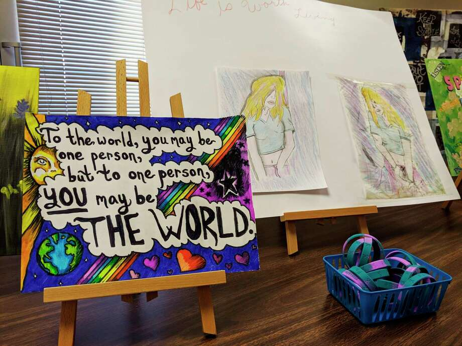 Last year's entries from the Manistee Friendship Society's suicide prevention awareness contest sit on display. This year's contest is open to the public,with projects due on Sept. 16. (File photo)
