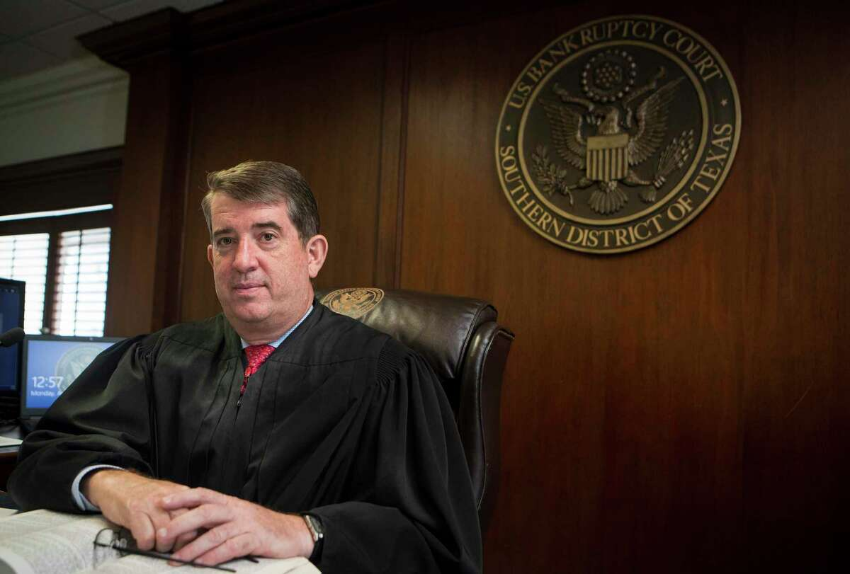 Chief United States Bankruptcy Judge David R. Jones sits on the bench before hearing closing arguments via a computer connection in his empty courtroom at the Bob Casey Federal Courthouse on Monday, Aug. 31, 2020 in Houston. Judge Jones has built the local court into one of the busiest in the nation, one that handles a number of complex bankruptcies.