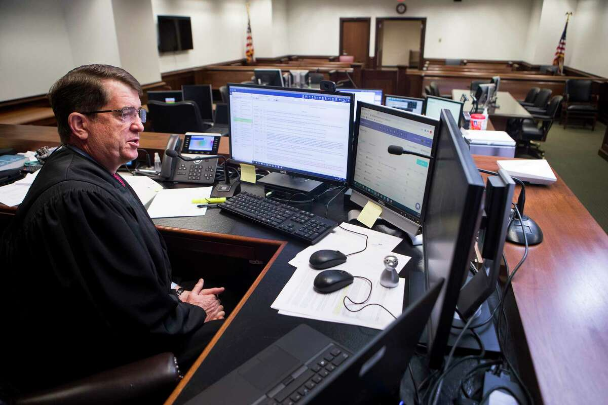 Chief United States Bankruptcy Judge David R. Jones hears closing arguments via a computer connection in his empty courtroom at the Bob Casey Federal Courthouse on Monday, Aug. 31, 2020 in Houston. Judge Jones has built the local court into one of the busiest in the nation, one that handles a number of complex bankruptcies.