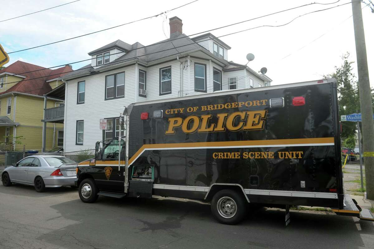 Police at the scene Monday afternoon outside a home at the corner of Washington Terrance and Washington Place, in Bridgeport, Conn. Aug. 31, 2020. Police confirmed that 22-year-old Karla Bermudez was killed after multiple gunshots were fired into the home early Monday morning.