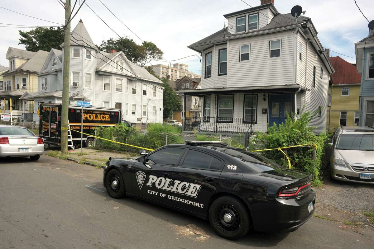 Police remained at the scene Monday afternoon outside a home at the corner of Washington Terrance and Washington Place, in Bridgeport, Conn. Aug. 31, 2020. Police confirmed that 22-year-old Karla Bermudez was killed after multiple gunshots were fired into the home early Monday morning.