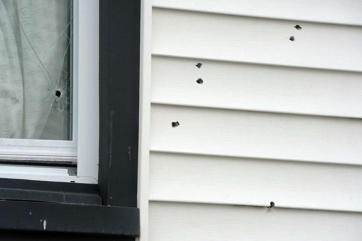 Bullet holes seen in the window and siding of a home at the corner of Washington Terrance and Washington Place, in Bridgeport, Conn. Aug. 31, 2020. Police confirmed that 22-year-old Karla Bermudez was killed after multiple gunshots were fired into the home early Monday morning.