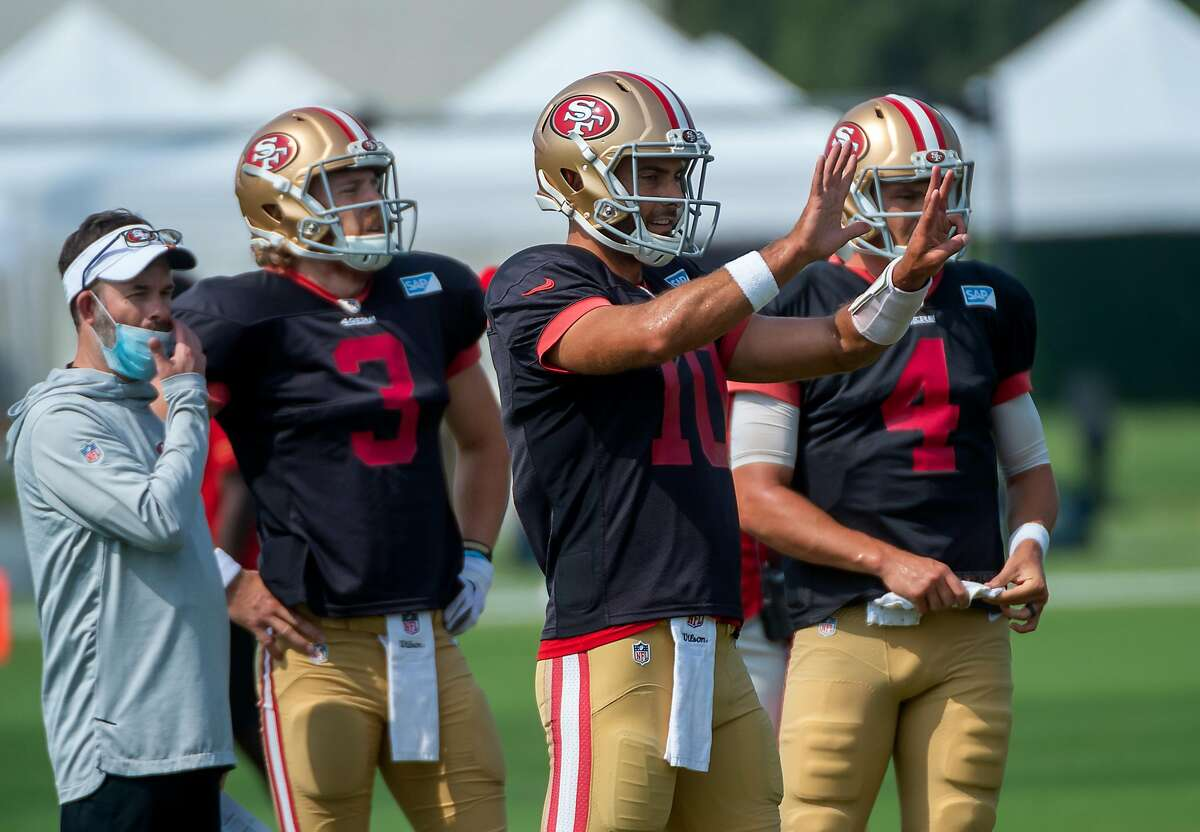 San Francisco 49ers quarterback Jimmy Garoppolo (10) gives directions with fellow QBs C.J. Beathard (3) and Nick Mullens (4) during training camp at Levi's Stadium on Tuesday, Aug 25, 2020 in Santa Clara.