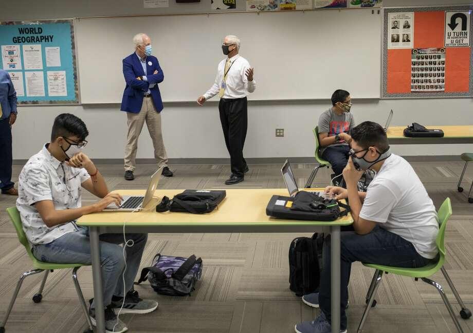 U.S. Sen. John Cornyn, left, visits with geography teacher Gary Dutchover on Monday, Aug. 31, 2020 as DutchoverÕs students do an activity at New Tech Odessa. Photo: Jacy Lewis/Reporter-Telegram / MRT
