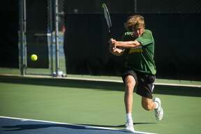 Dow's Tom Wood returns the ball during a No. 2 singles match against Midland's Evan Johnson Monday, Aug. 31, 2020 at the Greater Midland Tennis Center. (Katy Kildee/kkildee@mdn.net)